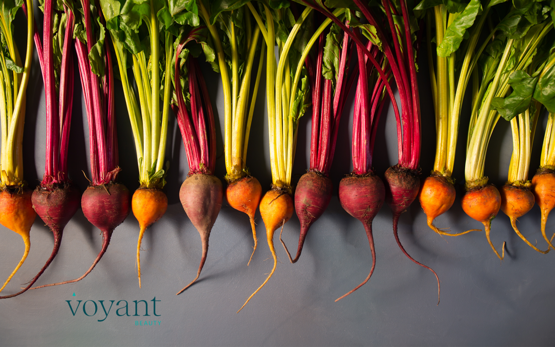 A row of beets lying on a table
