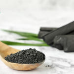 charcoal powder in a wooden spoon